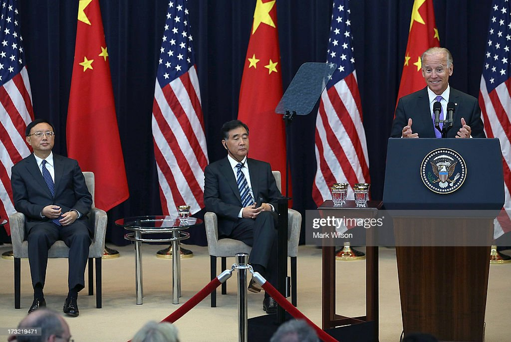 U.S. Vice President Joseph Biden (R), speaks while Chinese State Councilor Yang Jiechi (L), Chinese Vice Premier Wang Qishan (2nd-L), listen during the opening session of the U.S. and China Strategic and Economic Dialogue at the U.S. Department of State July 10, 2013 in Washington, DC. Officials from the United States and China are meeting in Washington for the 5th U.S. and China Strategic and Economic Dialogue.