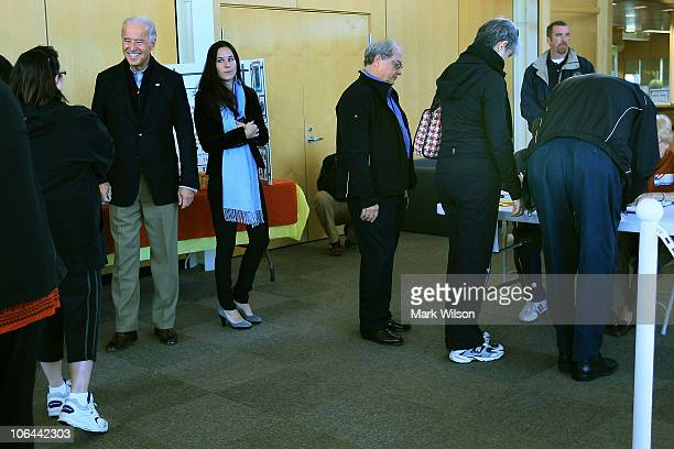 S Vice President Joseph Biden stands in line to vote with his daughter Ashley Biden at a polling station on November 2 2010 in Wilmington Delaware...