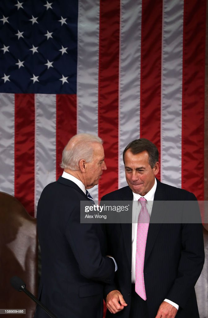 U.S. Vice President <a gi-track='captionPersonalityLinkClicked' href=/galleries/search?phrase=Joseph+Biden&family=editorial&specificpeople=206897 ng-click='$event.stopPropagation()'>Joseph Biden</a> (L) talks to Speaker of the House U.S. Rep. <a gi-track='captionPersonalityLinkClicked' href=/galleries/search?phrase=John+Boehner&family=editorial&specificpeople=274752 ng-click='$event.stopPropagation()'>John Boehner</a> (R-OH) during a joint session of the 113th Congress to count the Electoral College votes January 4, 2013 on Capitol Hill in Washington, DC. The Senate and the House held a joint session to count the Electoral College votes for the 2012 presidential election.