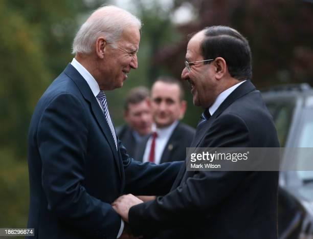 Vice President Joseph Biden welcomes Iraqi Prime Minister Nuri alMaliki to the Naval Observatory October 30 2013 in Washington DC Vice President...