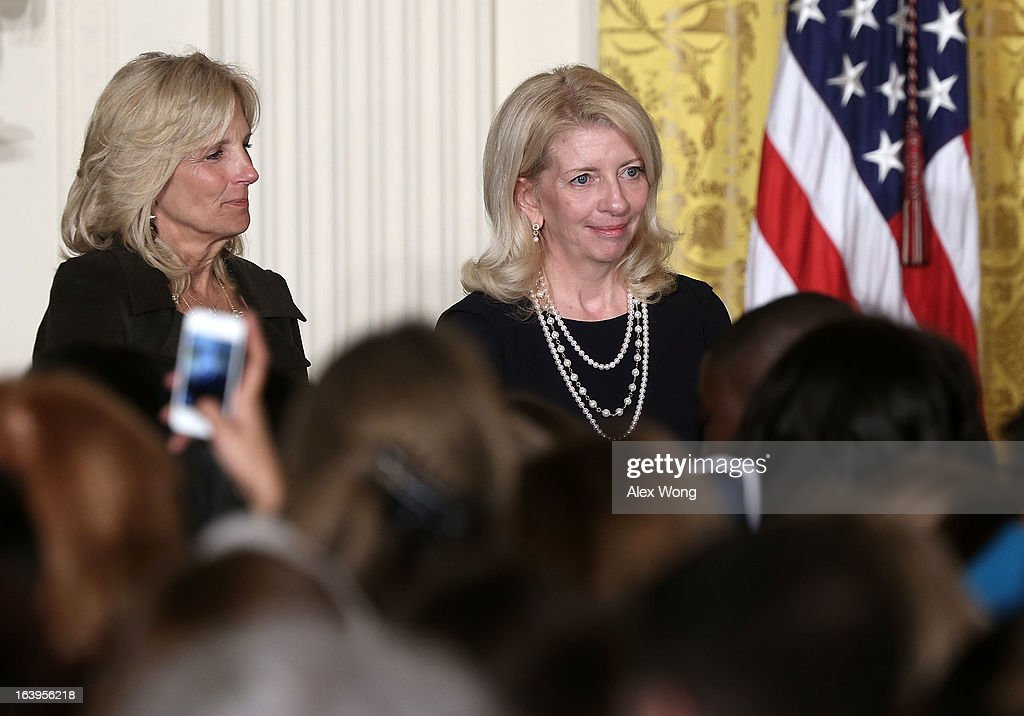 Vice President Joseph Biden's wife Jill Biden (L) and her chief of staff Catherine Russell (R) listen to remarks of President Barack Obama during a Women's History Month Reception in the East Room of the White House March 18, 2013 in Washington, DC. President Obama has nominated Russell as the next ambassador-at-large for global women's issues.