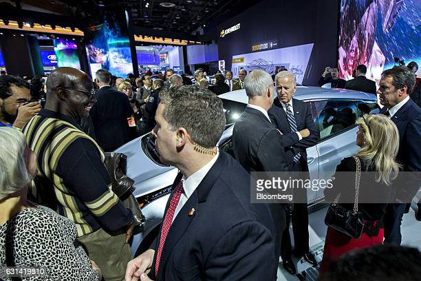 US Vice President Joseph 'Joe' Biden center right stands next to a General Motors Co Bolt EV with Mark Reuss executive vice president of global...