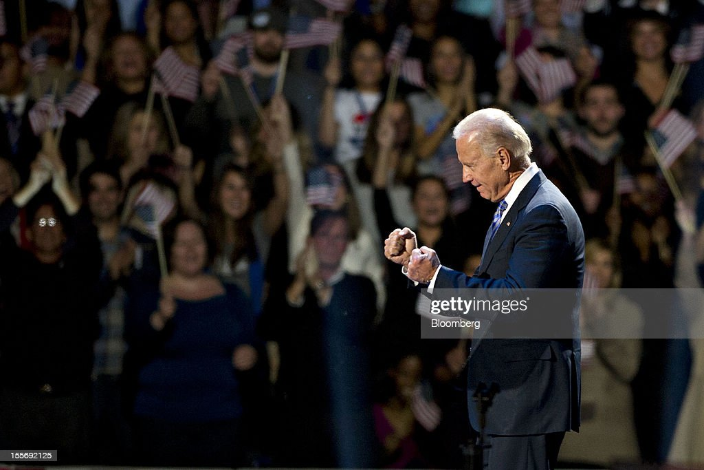 U.S. Vice President Joseph 'Joe' Biden gestures on stage as he celebrates during an election night rally in Chicago, Illinois, U.S., in the early morning on Wednesday, Nov. 7, 2012. President Barack Obama, the post-partisan candidate of hope who became the first black U.S. president, won re-election today by overcoming four years of economic discontent with a mix of political populism and electoral math. Photographer: Daniel Acker/Bloomberg via Getty Images