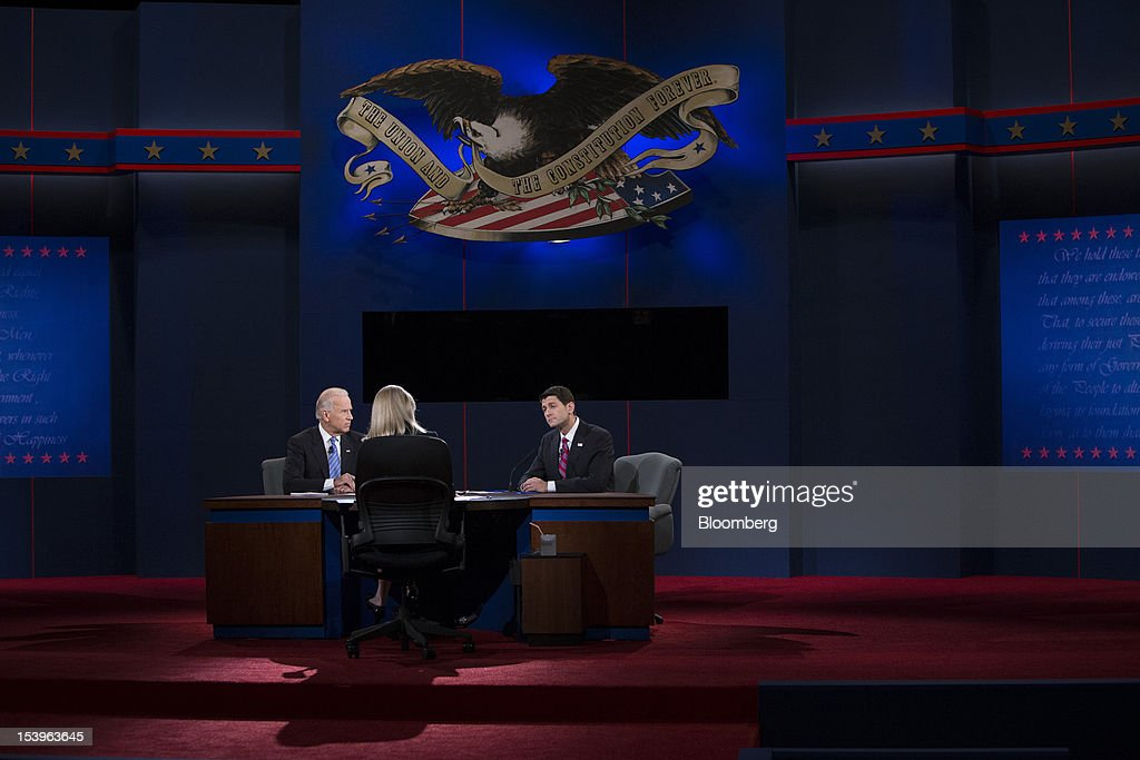 "U.S. Vice President Joseph 'Joe' Biden, left, and Representative Paul Ryan, Republican vice presidential candidate, right, attend a debate moderated by Martha Raddatz of ABC News in Danville, Kentucky, U.S., on Thursday, Oct. 11, 2012. Paul Ryan said President Barack Obama is presiding over a ""chaotic"" foreign policy that is 'unraveling'' and making the US. ""less safe,"" as he began his debate tonight with Joe Biden. Photographer: Scott Eells/Bloomberg via Getty Images"