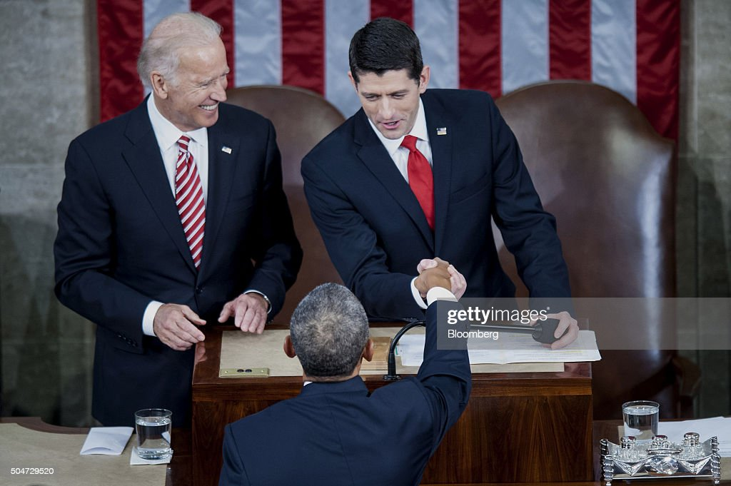 U.S. Vice President Joseph 'Joe' Biden, left, looks on as U.S. House Speaker Paul Ryan, a Republican from Wisconsin, right, greets U.S. President Barack Obama as he arrives to deliver the State of the Union address to a joint session of Congress at the Capitol in Washington, D.C., U.S., on Tuesday, Jan. 12, 2016. Obama said he regrets that political divisiveness in the U.S. grew during his seven years in the White House and he plans to use his final State of the Union address Tuesday night to call for the nation to unite. Photographer: Pete Marovich/Bloomberg via Getty Images