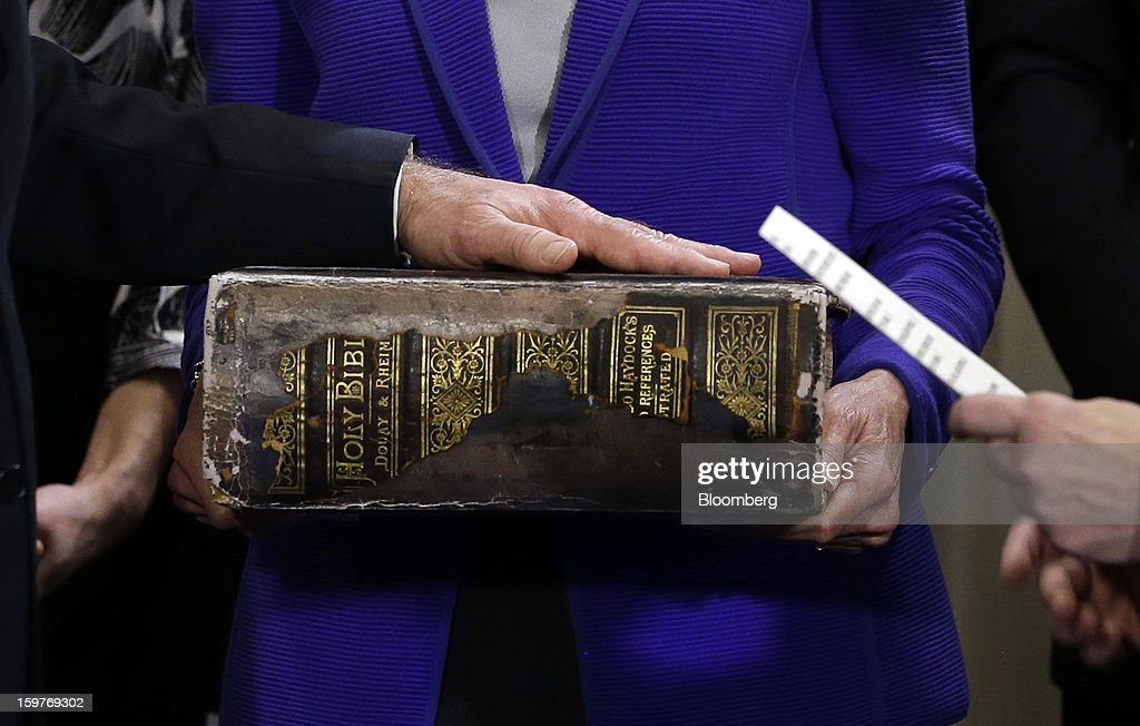 U.S. Vice President Joseph 'Joe' Biden, left, places his hand on the Biden Family Bible held by his wife <a gi-track='captionPersonalityLinkClicked' href=/galleries/search?phrase=Jill+Biden&family=editorial&specificpeople=997040 ng-click='$event.stopPropagation()'>Jill Biden</a>, center, as he takes the oath of office from Supreme Court Justice Sonia Sotomayor, right, during and official ceremony at the Naval Observatory,in Washington, D.C., U.S., on Sunday, Jan. 20, 2013. U.S. President Barack Obama is also set to take the oath of office later today surrounded by close friends and advisers in a small ceremony at the White House that will officially begin his second term in office. Photographer: Carolyn Kaster/Pool via Bloomberg
