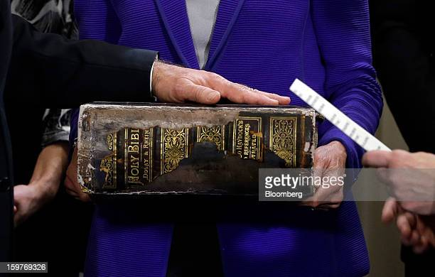 US Vice President Joseph 'Joe' Biden left places his hand on the Biden Family Bible held by his wife Jill Biden center as he takes the oath of office...
