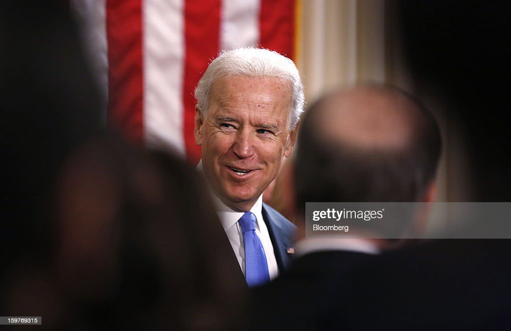 U.S. Vice President Joseph 'Joe' Biden smiles during the official swearing-in ceremony at the Naval Observatory in Washington, D.C., U.S., on Sunday, Jan. 20, 2013. U.S. President Barack Obama is also set to take the oath of office later today surrounded by close friends and advisers in a small ceremony at the White House that will officially begin his second term in office. Photographer: Kevin Lamarque/Pool via Bloomberg