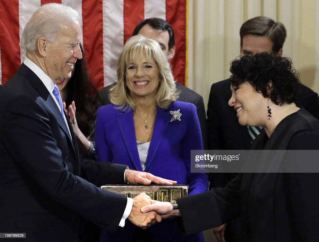U.S. Vice President Joseph 'Joe' Biden, with his wife <a gi-track='captionPersonalityLinkClicked' href=/galleries/search?phrase=Jill+Biden&family=editorial&specificpeople=997040 ng-click='$event.stopPropagation()'>Jill Biden</a>, center, holding the Biden family Bible, shakes hands with Supreme Court Justice <a gi-track='captionPersonalityLinkClicked' href=/galleries/search?phrase=Sonia+Sotomayor&family=editorial&specificpeople=5872777 ng-click='$event.stopPropagation()'>Sonia Sotomayor</a> during an official ceremony at the Naval Observatory in Washington, D.C., U.S., on Sunday, Jan. 20, 2013. U.S. President Barack Obama is also set to take the oath of office later today surrounded by close friends and advisers in a small ceremony at the White House that will officially begin his second term in office Photographer: Josh Haner/Pool via Bloomberg