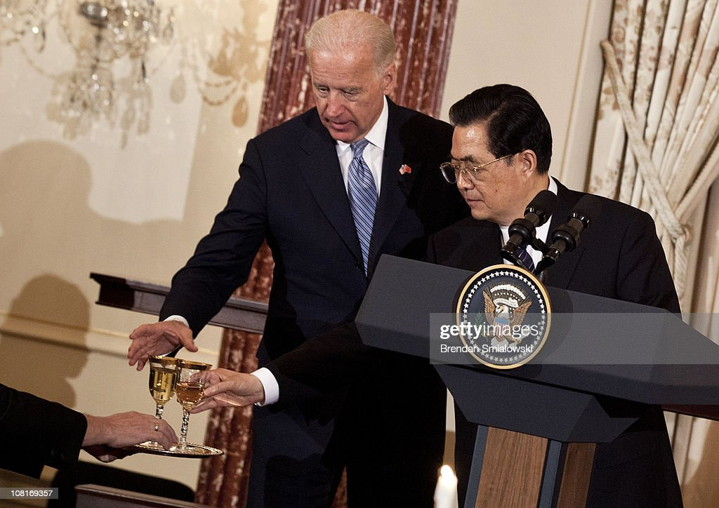 Vice President Joseph R. Biden and Chinese President Hu Jintao reach for glasses for a toast during a luncheon at the US State Department 19, 2011 in Washington, DC. Secretary of State Hillary Rodham Clinton and Vice President Joseph R. Biden hosted Chinese President Hu Jintao, who is in the United States for a state visit, for a luncheon.