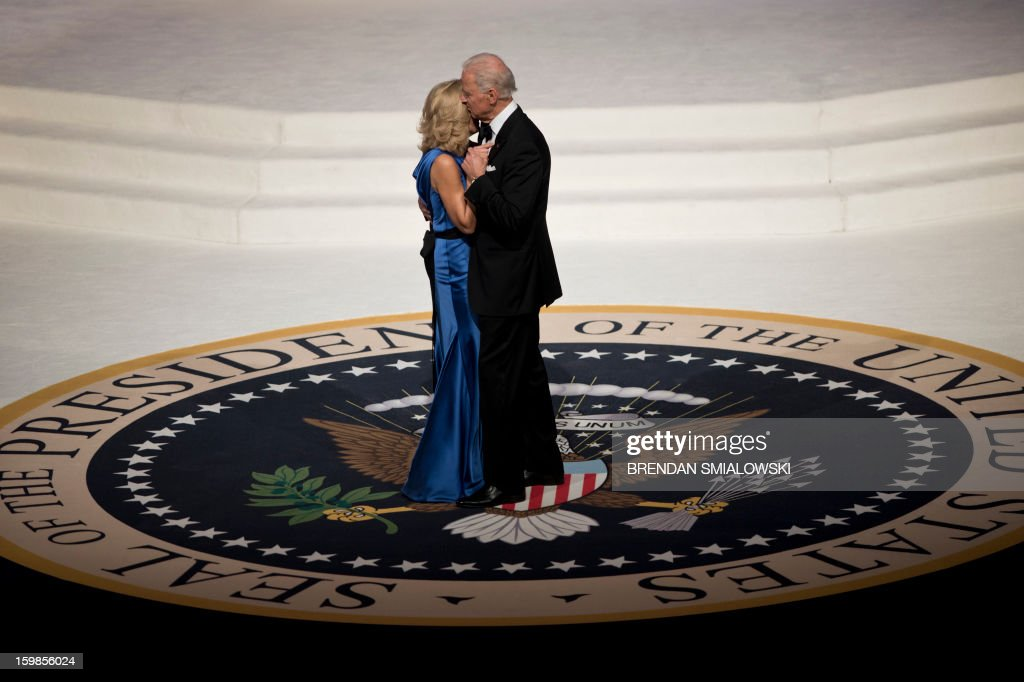 US Vice President Joseph R. Biden and Dr. Jill Biden dance while attending the Commander and Chief Ball at the Washington Convention Center January 21, 2013 in Washington, DC. Obama and Biden attended Inauguration balls after being ceremonially sworn in for a second term leading the United States earlier today. AFP PHOTO/Brendan SMIALOWSKI