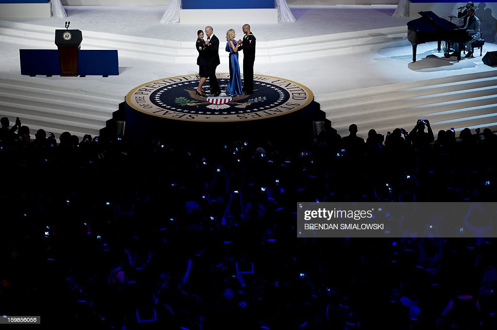 US Vice President Joseph R. Biden and Dr. Jill Biden dance with service members while attending the Commander in Chief Ball at the Washington Convention Center January 21, 2013 in Washington, DC. Obama and Biden attended Inauguration balls after being ceremonially sworn in for a second term leading the United States earlier today. AFP PHOTO/Brendan SMIALOWSKI