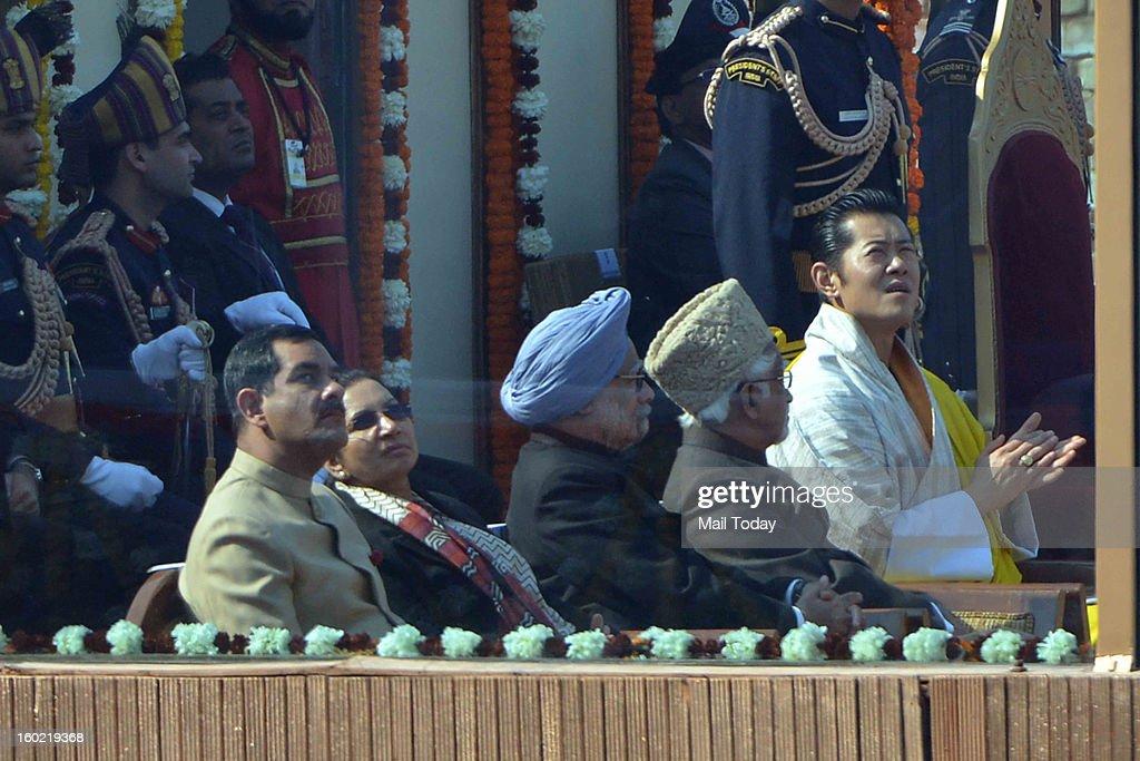Vice President M Hamid Ansari, chief guest King of Bhutan, Jigme Khesar Namgyel Wangchuck, Prime Minister Manmohan Singh enjoy watching an air show during 64th Republic Day celebrations in New Delhi on Saturday.