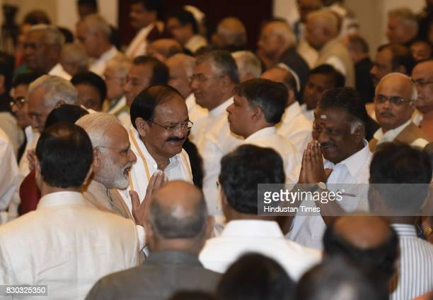 Vice President M Venkaiah Naidu with Prime Minister Narendra Modi greets people after oath taking ceremony of the 13th VicePresident of India at...
