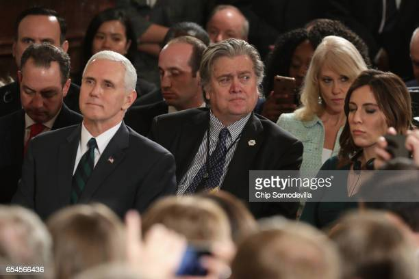 S Vice President Mike Pence and Chief Strategist Steve Bannon look on as US President Donald Trump holds a joint press conference with German...