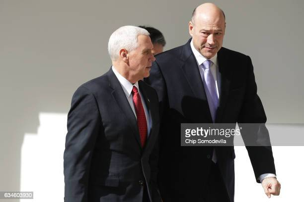 Vice President Mike Pence and Director of the National Economic Council Gary Cohn walk down the West Wing Colonnade following a bilateral meeting...