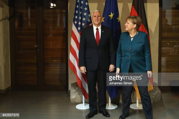 S Vice President Mike Pence and German chancellor Angela Merkel pose at the 2017 Munich Security Conference on February 18 2017 in Munich Germany The...