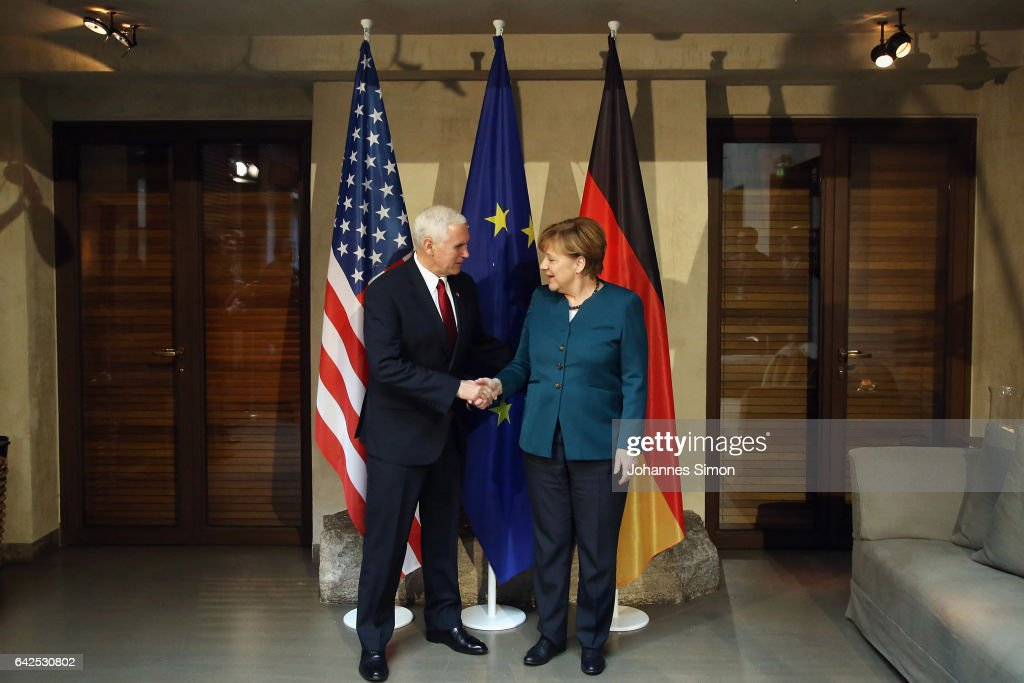 U.S. Vice President Mike Pence (L) and German chancellor Angela Merkel shake hands at the 2017 Munich Security Conference on February 18, 2017 in Munich, Germany. The 2017 Munich Security Conference, which brings together leading government figures from across the globe to discuss issues of common security concern, is taking place in the wake of the ascendence of Donald Trump to the U.S. presidency and the appointment of a new U.S. government cabinet. Trump has repeatedly called for a more isolationist United States, which has caused alarm among many world leaders concerned about the U.S.'s continued commitment to matters of global security.