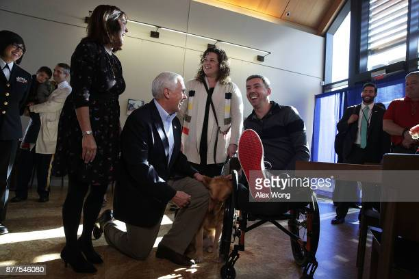 S Vice President Mike Pence and his wife Karen Pence greet Marine Corps veteran Liam Dwyer and his wife Meghan at the USO Warrior and Family Center...