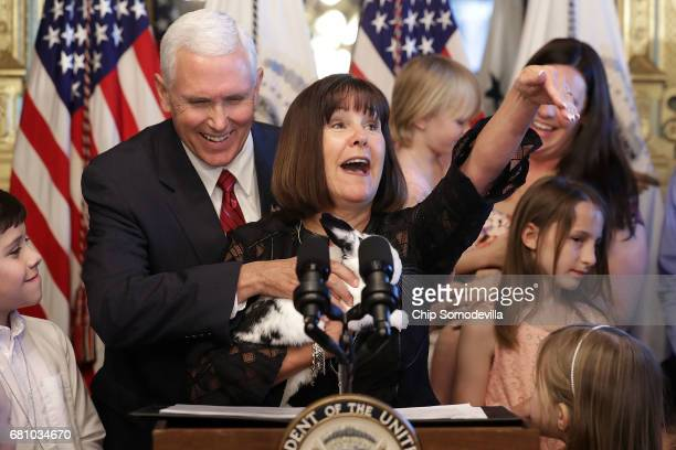 Vice President Mike Pence and his wife Karen Pence hold their family rabbit 'Marlon Bundo' during and event with military families celebrating...