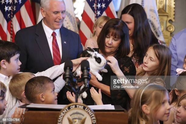 Vice President Mike Pence and his wife Karen Pence let children pet their family rabbit 'Marlon Bundo' during and event with military families...