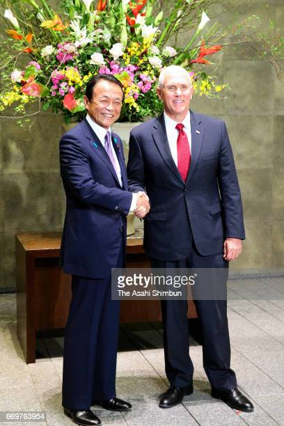 US Vice President Mike Pence and Japanese Deputy Prime Minister and Finance Minister Taro Aso shake hands prior to their meeting at Prime Minister...