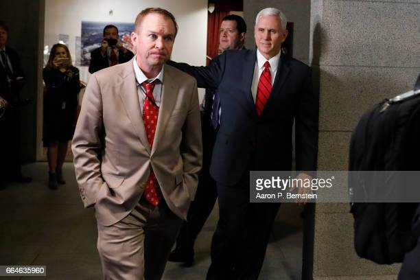 US Vice President Mike Pence and Office of Management and Budget Mick Mulvaney arrive at a meeting of House Republicans on Capitol Hill April 4 2017...
