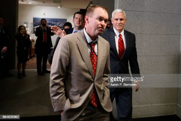 Vice President Mike Pence and Office of Management and Budget Mick Mulvaney arrive at a meeting of House Republicans on Capitol Hill April 4 2017 in...