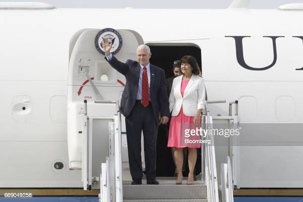 US Vice President Mike Pence and Second Lady Karen Pence wave as they arrive at Osan air base in Pyeongtaek South Korea on Sunday April 16 2017 North...