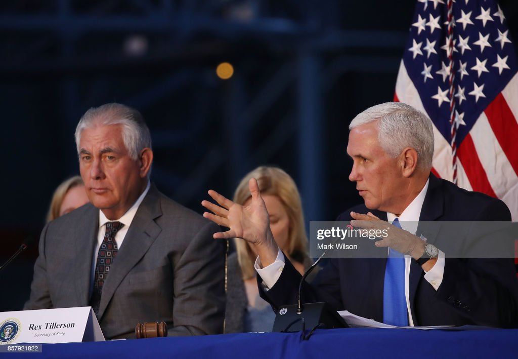 Vice President Mike Pence (R), and Secretary of State Rex Tillerson participate in the inaugural meeting of the National Space Council, titled 'Leading the Next Frontier' at the National Air and Space Museum, Steven F. Udvar-Hazy Center, October 5, 2017 in Chantilly, Virginia. Originally formed in 1958, this is the first meeting of the newly reestablished council in 20 years.