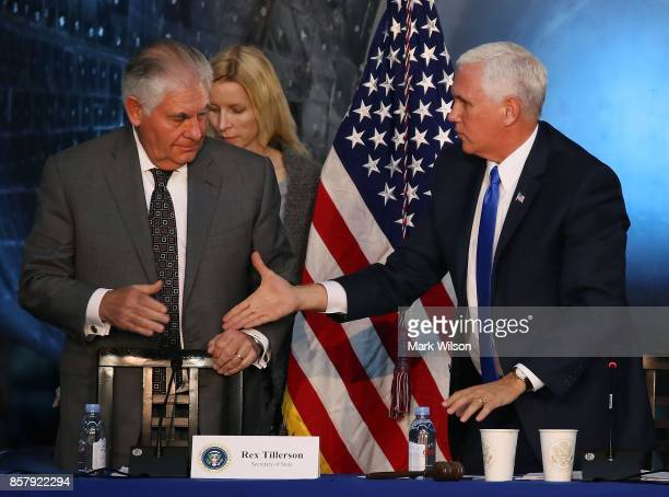 Vice President Mike Pence and Secretary of State Rex Tillerson shake hands at the end of the inaugural meeting of the National Space Council titled...