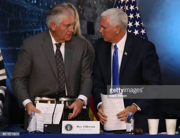 Vice President Mike Pence and Secretary of State Rex Tillerson talk at the end of the inaugural meeting of the National Space Council titled 'Leading...