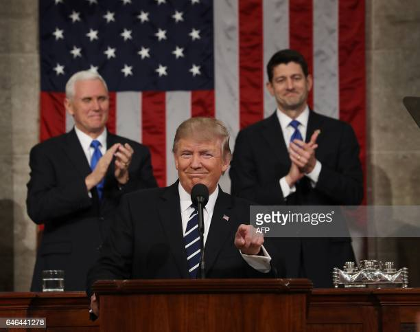 US Vice President Mike Pence and Speaker of the House Paul Ryan applaud as US President Donald J Trump arrives to deliver his first address to a...