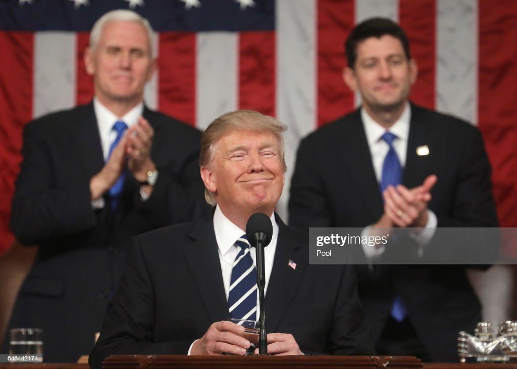 U.S. Vice President Mike Pence (L) and Speaker of the House Paul Ryan (R) applaud as U.S. President Donald J. Trump (C) delivers his first address to a joint session of the U.S. Congress on February 28, 2017 in the House chamber of the U.S. Capitol in Washington, DC. Trump's first address to Congress is expected to focus on national security, tax and regulatory reform, the economy, and healthcare.