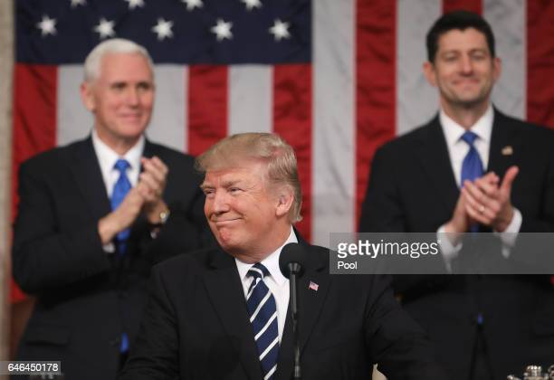 US Vice President Mike Pence and Speaker of the House Paul Ryan applaud as US President Donald J Trump delivers his first address to a joint session...