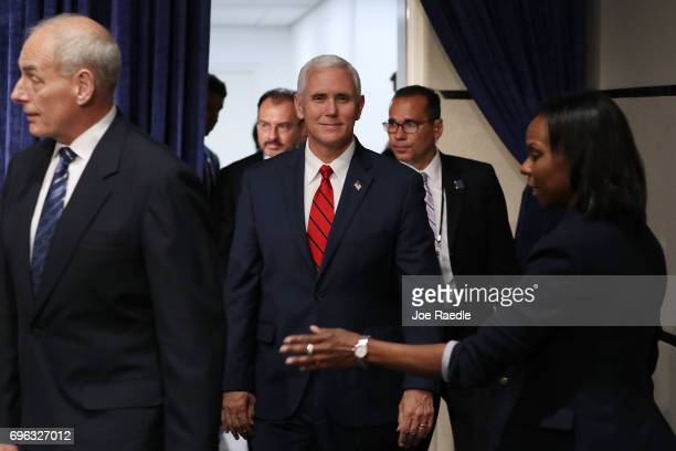 Vice President Mike Pence arrives for a photo opportunity with US Secretary of Homeland Security John F Kelly at the Conference on Prosperity and...