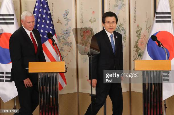 US Vice President Mike Pence attends with South Korean acting president and prime minister Hwang Kyoahn during their joint press conference on April...
