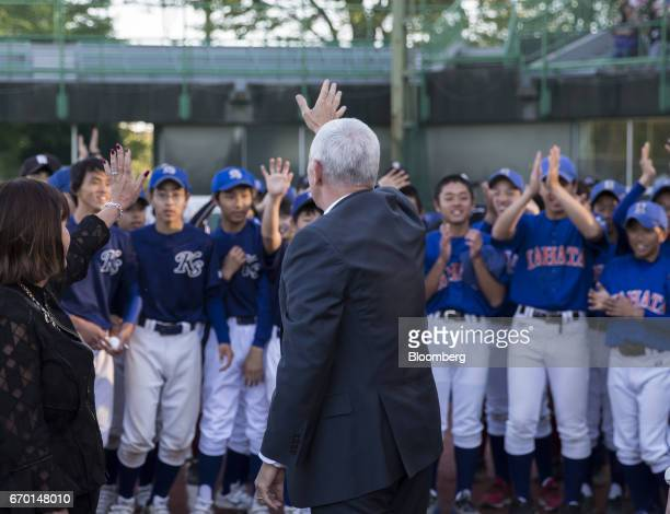 US Vice President Mike Pence center and second lady Karen Pence left wave as they leave a Japanese youth baseball and softball clinic in Tokyo Japan...