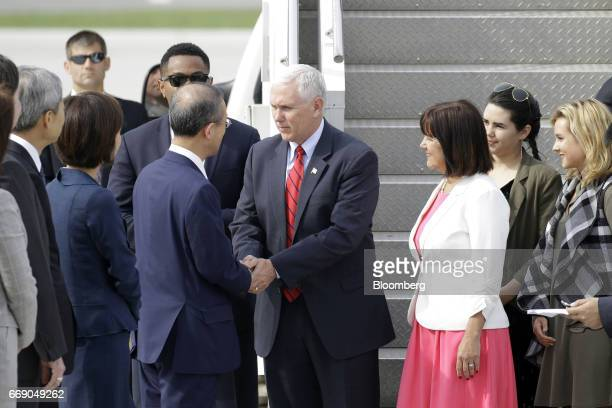 US Vice President Mike Pence center and Second Lady Karen Pence second right are greeted as they arrive at Osan air base in Pyeongtaek South Korea on...