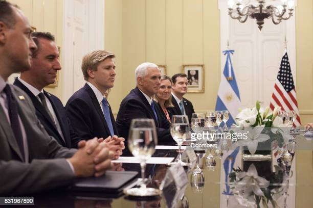 US Vice President Mike Pence center listens during a meeting with Gabriela Michetti Argentina's vice president not pictured at the Presidential...