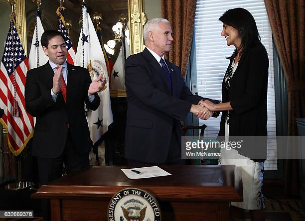 US Vice President Mike Pence congratulates Nikki Haley at the end of the ceremomy where she was sworn in as the US Ambassador to the United Nations...