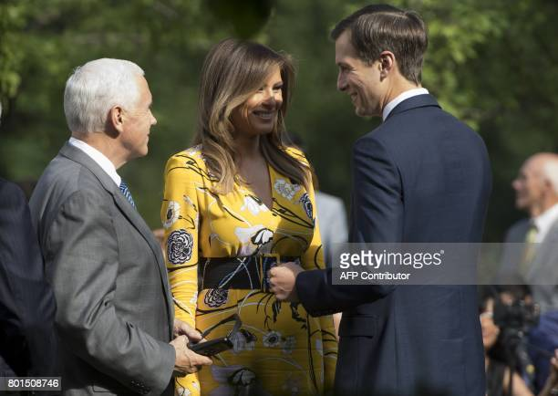 US Vice President Mike Pence First Lady Melania Trump and Jared Kushner Senior adviser and US President Donald Trump's soninlaw speak prior to Trump...