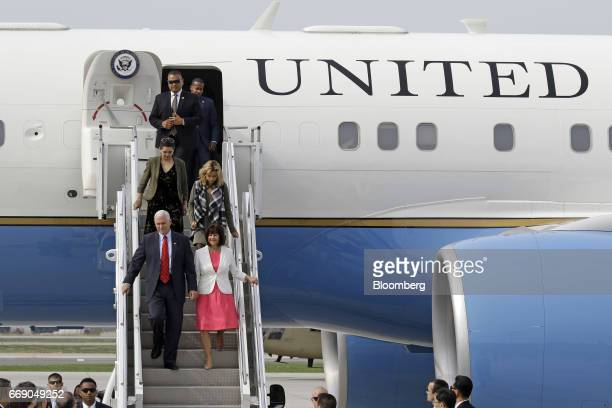 US Vice President Mike Pence front left and Second Lady Karen Pence front right exit a plane as they arrive at Osan air base in Pyeongtaek South...