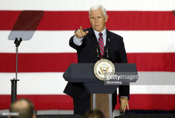 US Vice President Mike Pence gestures while speaking during an event at the American Axle Manufacturing Inc facility in Auburn Hills Michigan US on...