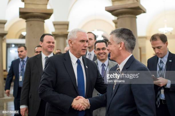 Vice President Mike Pence greets Frank Larkin Senate Sergeant at Arms in the crypt of the Capitol after Pence cast a tie breaking vote in the Senate...