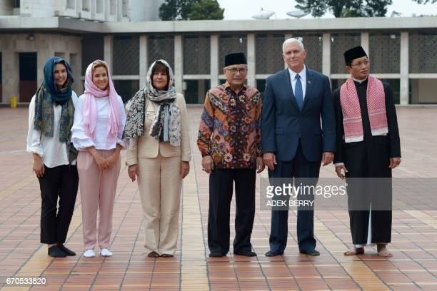 US Vice President Mike Pence his wife Karen and their daughters Charlotte and Audrey Muhammad Muzammil Basyuni and Nasarudin Umar from the Istiqlal...
