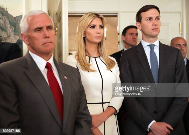 US Vice President Mike Pence Ivanka Trump and Senior Advisor to the President Jared Kushner listen to US President Donald Trump deliver brief remarks...