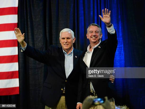 S Vice President Mike Pence left and gubernatorial candidate Ed Gillespie RVA wave during a campaign rally at the Washington County Fairgrounds on...