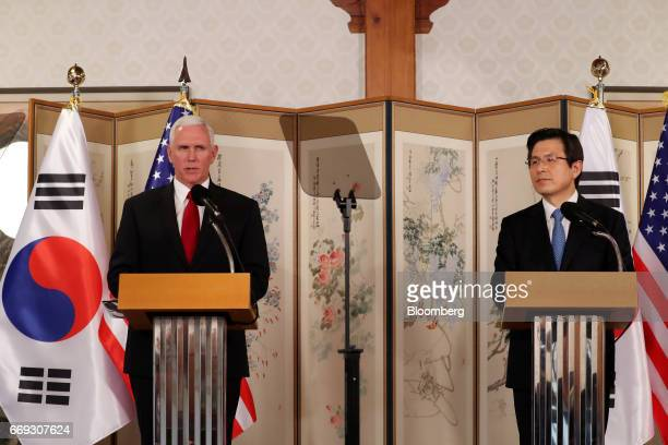 US Vice President Mike Pence left speaks during a joint news conference with Hwang Kyoahn South Korea's acting president and prime minister after a...