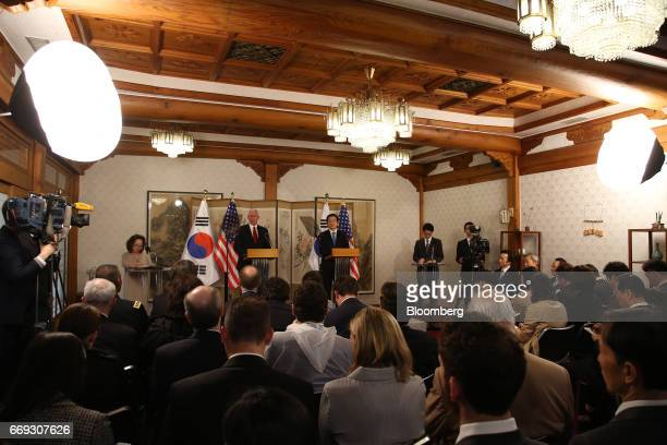 US Vice President Mike Pence left speaks during a joint news conference with Hwang Kyoahn South Korea's acting president and prime minister right...